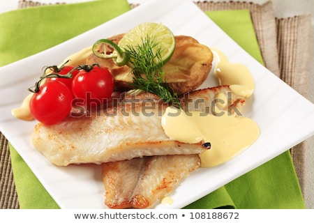 White fish fillets with potatoes and Hollandaise sauce Stock photo © Digifoodstock