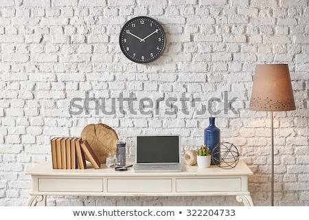Black clock hanging on the wood wall  Stock photo © teerawit