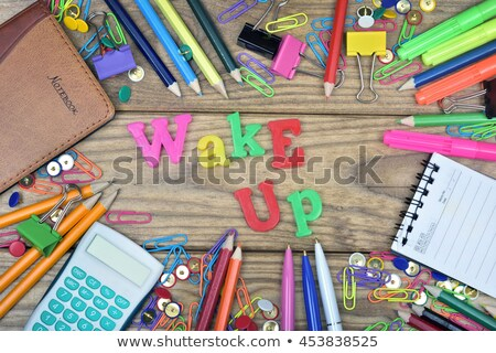 Wake up word and office tools on wooden table Stock photo © fuzzbones0