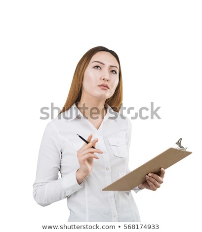 Beautiful pensive asian businesswoman holding clipboard and thinking about something Stock photo © deandrobot
