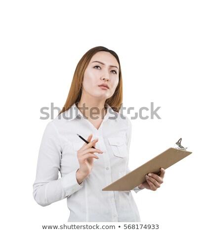 Belo pensativo asiático empresária clipboard Foto stock © deandrobot