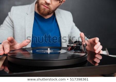 Draaitafel gebruikt geconcentreerde bebaarde man Stockfoto © deandrobot