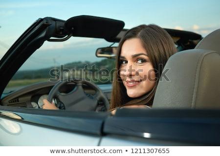 beautiful woman sitting in cabriolet enjoying trip on luxury mo stock photo © vlad_star