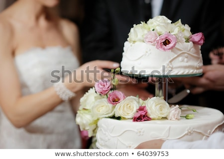 Bride and groom are eating their wedding cake Stock photo © tekso