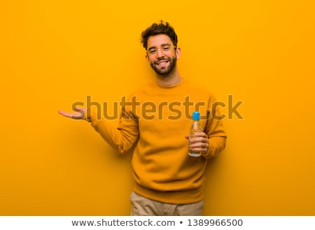 happy man holding something imaginary on hands Stock photo © dolgachov