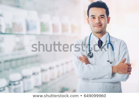 Young confident surgeon with arms crossed. Stock photo © RAStudio
