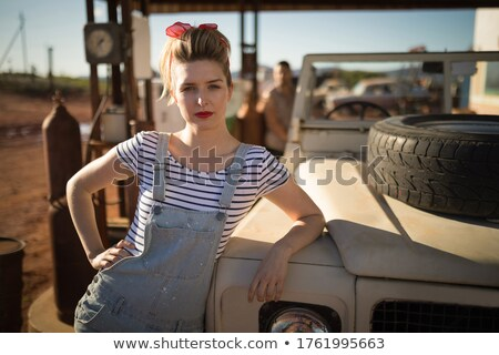 woman standing near a car at petrol pump stock photo © wavebreak_media