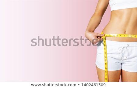Female measuring waist Stock photo © IS2