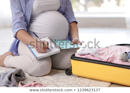 Pregnant woman packing maternity bag Stock photo © IS2