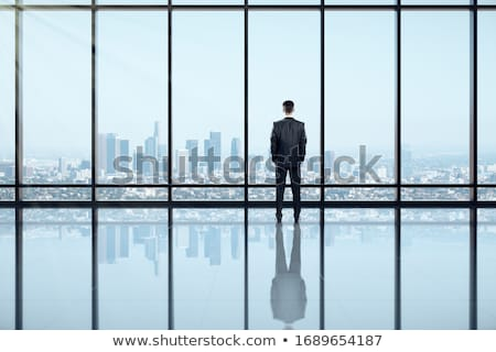 Business man standing in loft Stock photo © IS2