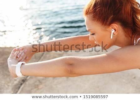 Fotografia · sportu · kobieta · posiedzenia · plaży - zdjęcia stock © deandrobot