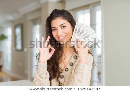 Indian femme signe du dollar main vêtements entreprise Photo stock © studioworkstock