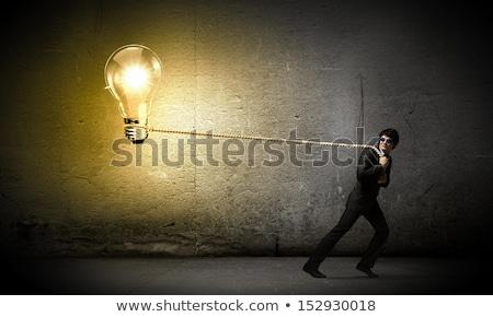 Kişi kordon ampul enerji elektrik Stok fotoğraf © IS2