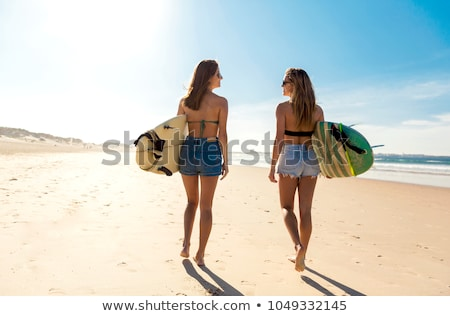 two girls at beach stock photo © massonforstock