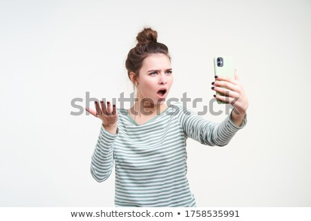 Photo of european woman 20s with brown hair talking on mobile ph Stock photo © deandrobot