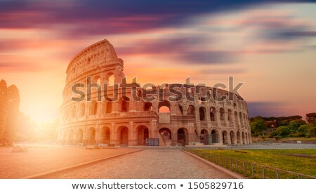 Colosseum and sunny sunrise Stock photo © Givaga