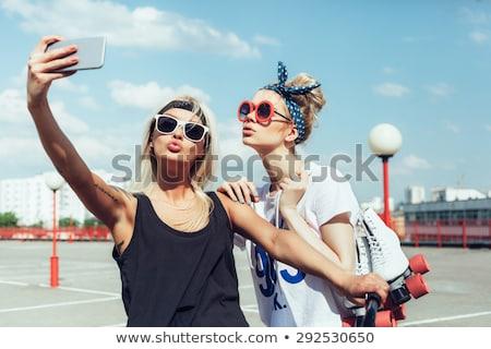 cheerful woman with smartphone and retro telephone stock photo © ichiosea