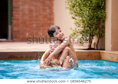 Stockfoto: Gelukkig · jonge · familie · binnenkant · zwembad