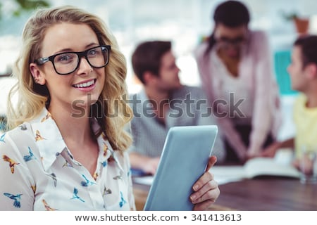 creative team with tablet pc working at office stock photo © dolgachov