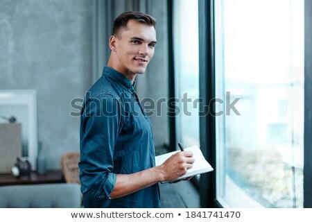 Adam ofis pencere işaretleyici sakallı Stok fotoğraf © Traimak