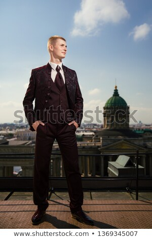portrait of a happy elegant young man in burgundy suit Stock photo © feedough
