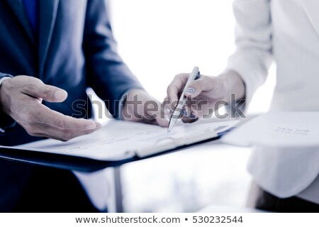 Business people reviewing financial data paperwork Stock photo © Kzenon