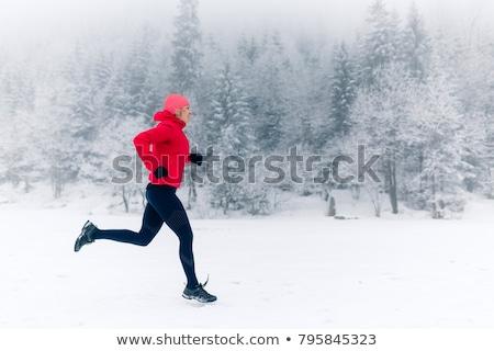 trail running girl in winter mountains stock photo © blasbike