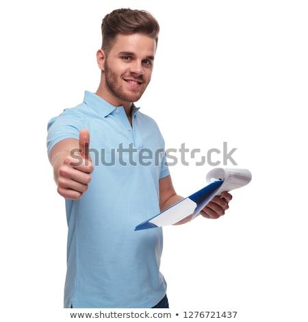 man wearing polo shirt checks files and makes ok sign Stock photo © feedough