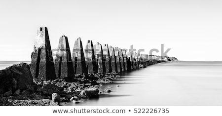 kövek · tengerpart · távoli · sziget · horizont · naplemente - stock fotó © taiga