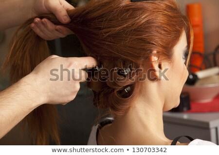 Beautiful bride having hairdo in her wedding day Stock photo © dashapetrenko