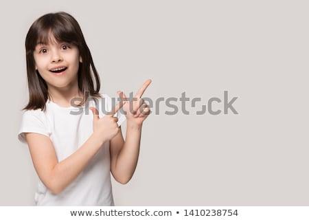 модный девушки бежевый позируют указывая камеры Сток-фото © studiolucky