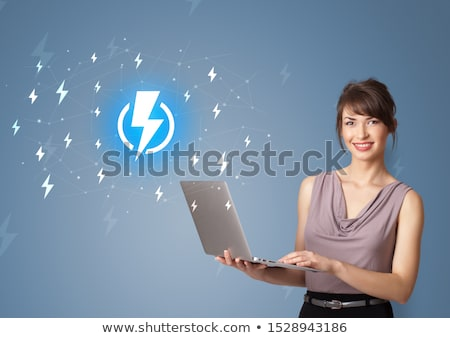Person presenting battery life concept Stock photo © ra2studio