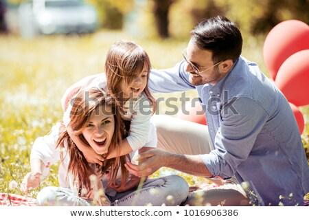 Сток-фото: смеясь · семьи · отец · матери · пикника · пляж