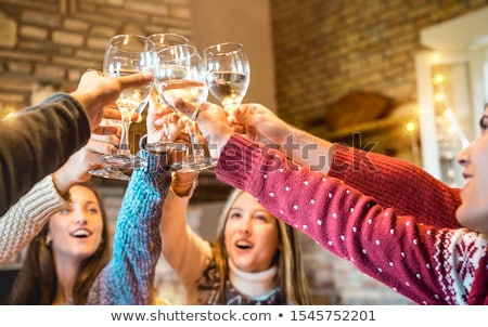 happy friends having christmas dinner at home Stock photo © dolgachov