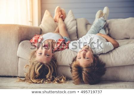 Bella bambina ragazzo divano famiglia sorriso Foto d'archivio © Lopolo