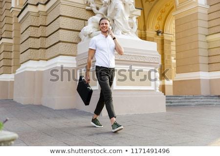 Tam uzunlukta görüntü mutlu iş adamı evrak çantası Stok fotoğraf © deandrobot