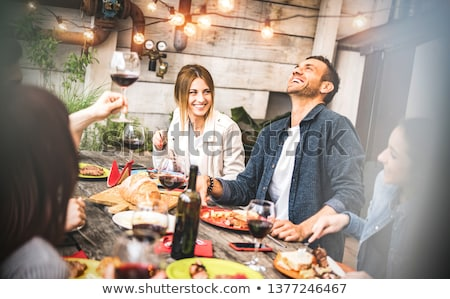 happy friends at barbecue party on rooftop Stock photo © dolgachov