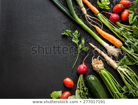 Fresh organic wet carrots and zucchini on black background.  Stock photo © marylooo