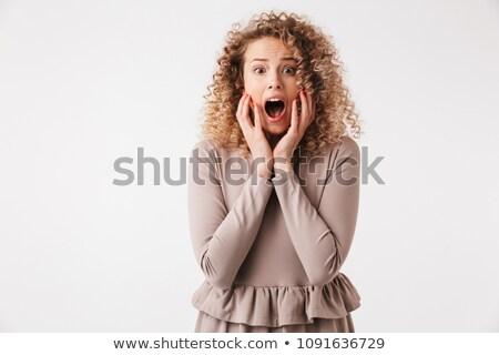 Geschokt blond gekruld vrouw jurk aanraken Stockfoto © deandrobot