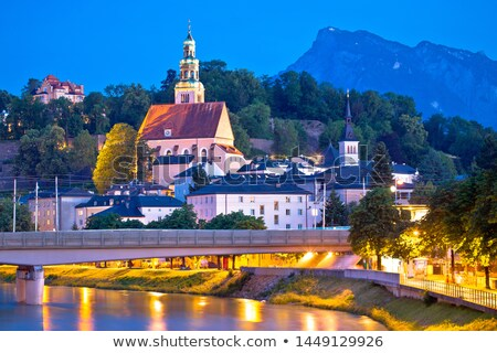 Salzburg historic architecture and mountain peaks background eve Stock photo © xbrchx