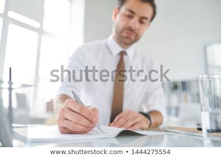 молодые занят брокер пер пустая страница Сток-фото © pressmaster