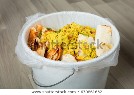 Dustbin Covered With Leftover Food Stock photo © AndreyPopov