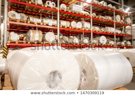 Stock photo: Racks of rolled and packed polyethylene film in storage area