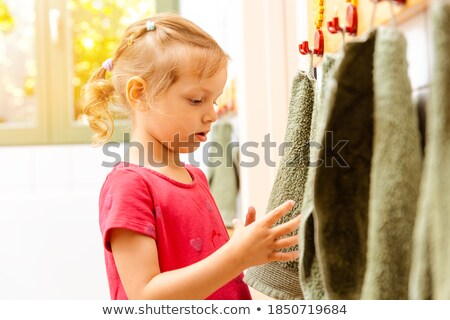 Little girl in nursery school using towel in bathroom Stock photo © Kzenon