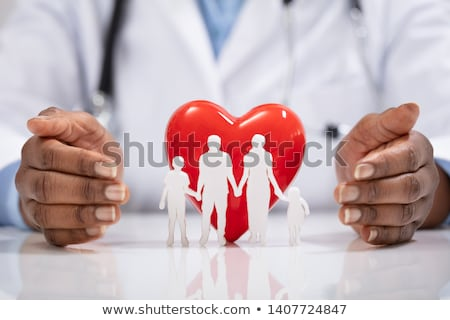family cut out with stethoscope and red heart on desk stock photo © andreypopov
