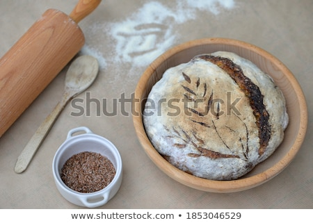 Bread with flax seeds in the hands of a baker Stock photo © galitskaya