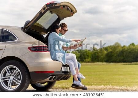 Glücklich Mann Frau Straßenkarte Auto Freizeit Stock foto © dolgachov