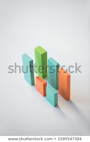 Two parallels of blue, orange and green wooden bricks forming financial charts Stock photo © pressmaster