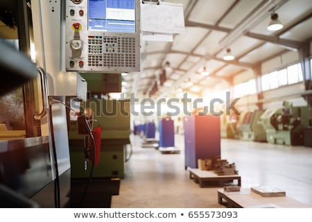 Worker in metal industry operating a modern cnc lathe Stock photo © Kzenon