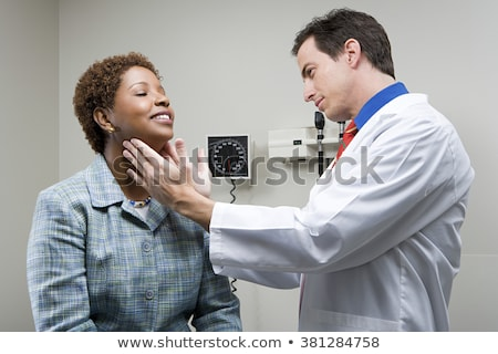 doctor checking patient's tonsils at hospital Stock photo © dolgachov